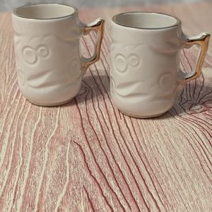 Pair of Espresso mugs with gold painted trim.